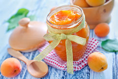 Apricot jam. In the glass benk Stock Photo