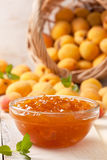 Apricot jam in a glass bowl Stock Photos