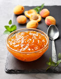 Apricot jam in a glass bowl Royalty Free Stock Photo
