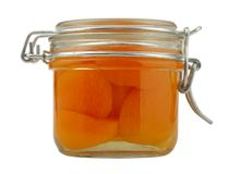 Apricot jam in a glass jar Royalty Free Stock Images