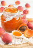 Apricot jam. In a glass jar Stock Photography