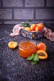 Apricot jam in glass jar Stock Image