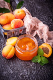 Apricot jam in glass jar Royalty Free Stock Photos