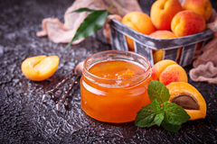 Apricot jam in glass jar Stock Photos