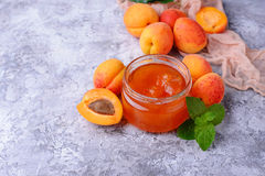Apricot jam in glass jar Stock Photography