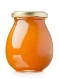 Apricot jam. Glass jar on white background stock image
