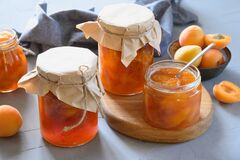 Apricot jam in glass jars. Summer harvest and canned food