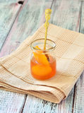 Apricot jam in a jar on napkin isolated light table Stock Photo
