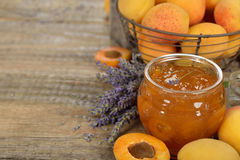Apricot jam with lavender. On a wooden background Stock Photos