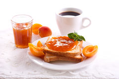 Apricot jam  over toasts Royalty Free Stock Photos