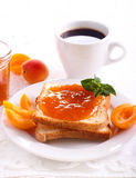 Apricot jam  over toasts Stock Image
