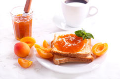 Apricot jam  over toasts Royalty Free Stock Photo