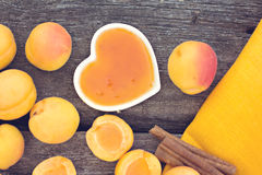 Apricot jam on rustic wooden Royalty Free Stock Images