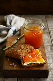 Apricot jam sandwich sunflower seeds on cutting board Royalty Free Stock Photos