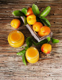 Apricot jam in small glass jars with fruits, selective focus Royalty Free Stock Images