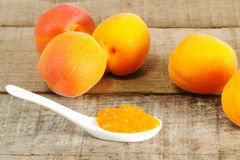 Apricot jam on spoon Royalty Free Stock Photography