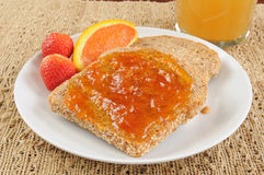 Apricot jam on toast Royalty Free Stock Photography