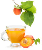 Apricot juice and apricots with leaves Royalty Free Stock Photos