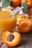 Apricot juice closeup on background basket with fruit. Stock Photo