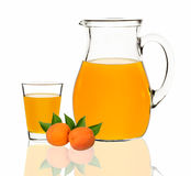 Apricot juice in a glass and carafe on a white background Royalty Free Stock Photo