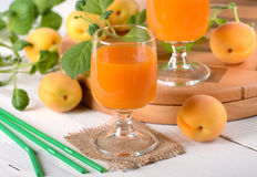 Apricot juice in the glass Royalty Free Stock Image