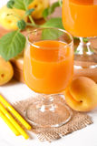 Apricot juice in the glass Stock Photography
