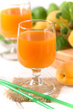 Apricot juice in the glass Stock Photos