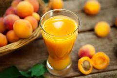 Apricot juice in a glass Stock Image