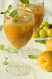 Apricot juice nectar and fresh apricots Stock Image