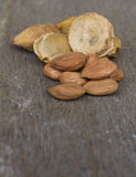 Apricot Kernels and pip on wood Stock Photo