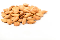 Apricot kernels. On white background Stock Photos