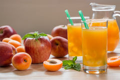 Apricot peach apple juice with ice. Royalty Free Stock Image