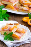 Apricot pie with a crumb. On white plate Royalty Free Stock Photography