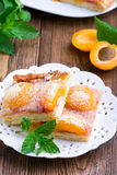 Apricot pie with a crumb. On white plate Stock Photo