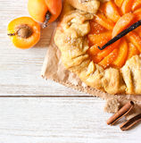 Apricot pie. Homemade apricot pie with vanilla and brown sugar on a wooden background with copy space for recipe Stock Image