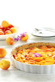 Apricot pie. On white wooden background stock photo