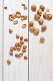 Apricot pits and shells. On a wooden table Royalty Free Stock Images