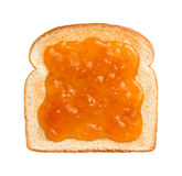 Apricot Preserves on Toast. Aerial view of Apricot Preserves on a single slice of lightly toasted white bread. Isolated on white Stock Photo