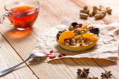 Apricot prune tart. Served with tea Stock Photography