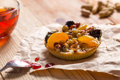 Apricot prune tart. Served with tea Royalty Free Stock Images
