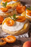 Apricot puff pastry with cream close-up. vertical Stock Photo
