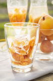 Apricot  punch with ice, preparation for drink Stock Images