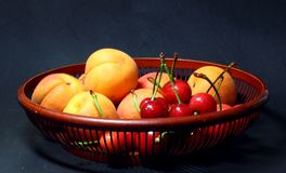 Apricot and red cherry Stock Images