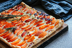 Apricot rustic pie on dinner table royalty free stock photos