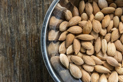 Apricot seeds in metal bowl Royalty Free Stock Image