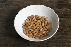 Apricot seeds in white bowl Stock Images