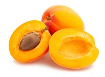 Apricot. Sliced apricot path isolated on white royalty free stock photo