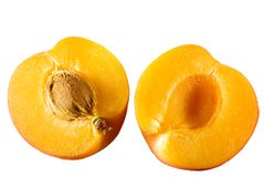 Apricot sliced in half isolated on white Stock Images