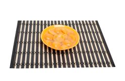 Apricot slices in bowl on placemat Royalty Free Stock Photo