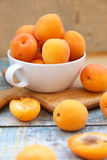 Apricot. Some fresh ripe raw juicy apricot on old wooden background Royalty Free Stock Photography